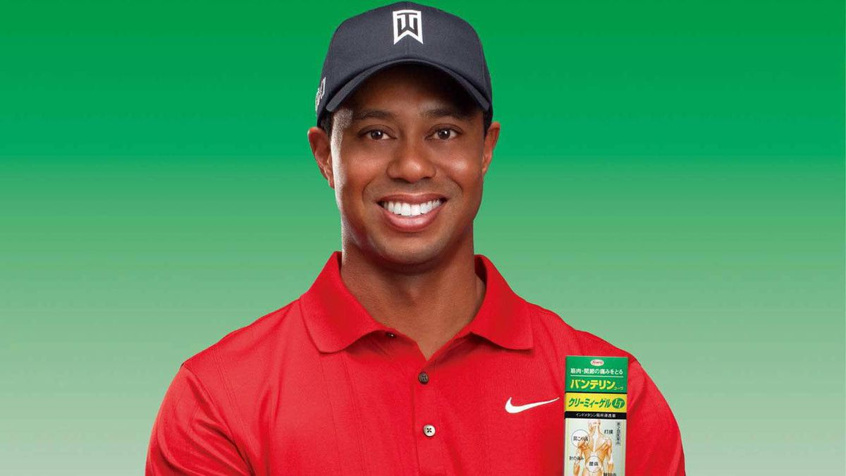 """This image provided by IMG shows Tiger Woods promoting a Japanese pain reliever, his first endorsement since he was caught in a sex scandal toward the end of 2009. The deal with Kowa Company Ltd. is geared only toward the market in Japan. Woods already has filmed commercials for """"Vantelin Kowa,"""" a heat rub used to relieve muscle and joint pain."""