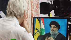 "Wikileaks founder Julian Assange interviews Hezbollah's leader Sayyed Hassan Nasrallah during his new ""The World Tomorrow"" talk show, in this frame taken from handout footage provided by Russia Today April 17, 2012."