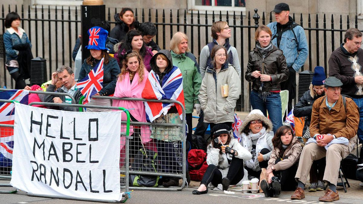 Royal supporters wait along the processional route on the day of the wedding of Britain's Prince William and Kate Middleton, in central London, on April 29, 2011.