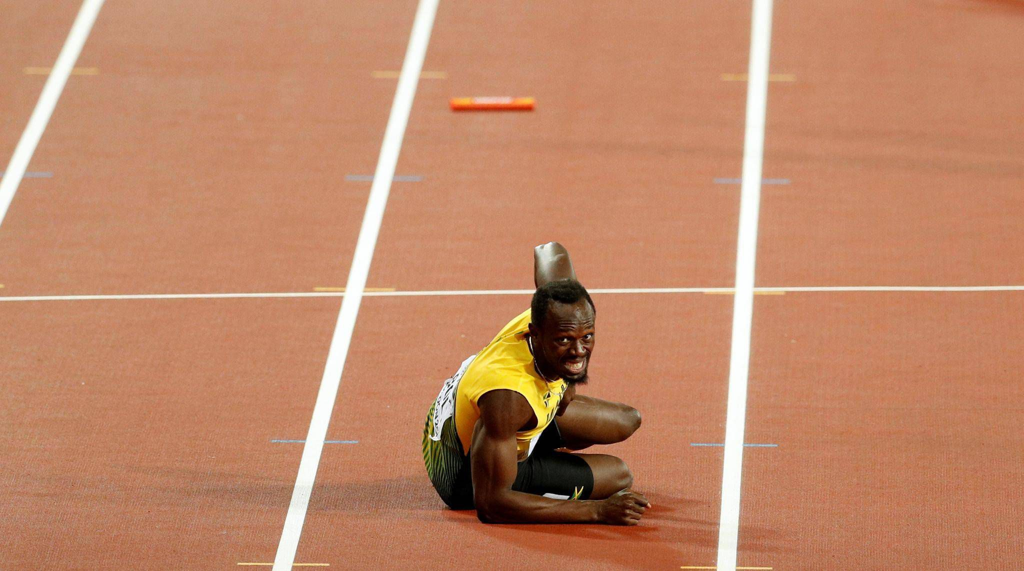 03ca4a495aa Bolt ends stellar career with injury in relay - The Globe and Mail