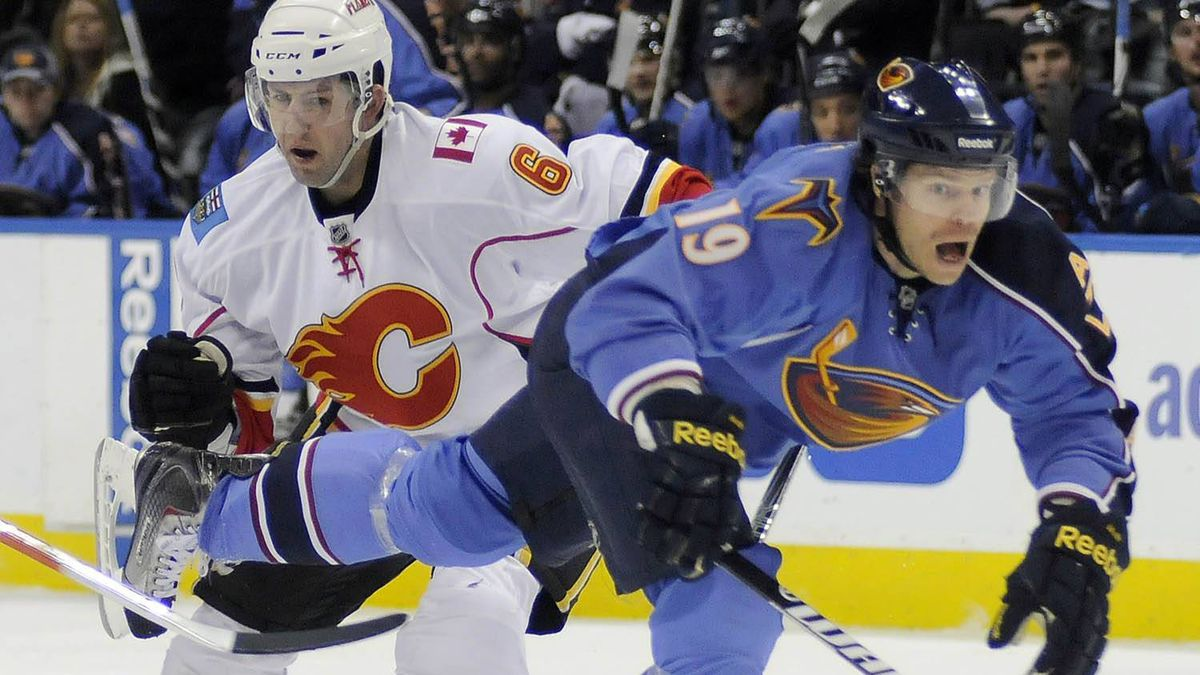 Atlanta Thrashers left wing Freddy Modin (R) gets tangled up by Calgary Flames defenseman Cory Sarich in the first period of their NHL hockey game in Atlanta, Georgia February 3, 2011. The Flames won 4-2. REUTERS/Tami Chappell