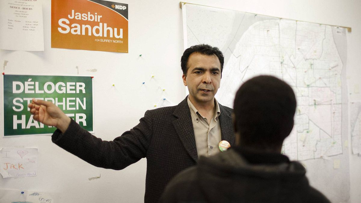 Surrey North New Democratic Party candidate, Jasbir Sandhu, gives directions to a nearby polling station to a voter at his campaign headquarters in Surrey, British Columbia, Monday, May 2, 2011.