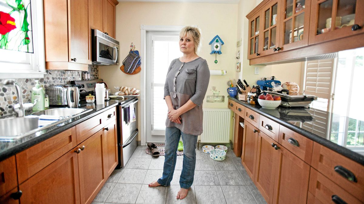 Pamela Tebbs, in the Toronto home she moved into in 2003. She's selling the former owner's estate and the real estate agents that handled the sale.