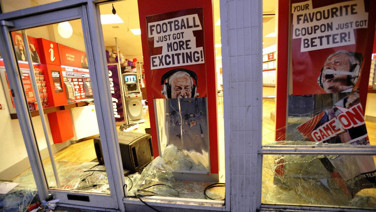 The vandalised frontage of a bookmakers shop is seen after being attacked by rioters in Peckham, London August 8, 2011. Youth hurled missiles at police in northeast London on Monday as violence broke out in the British capital for a third night.