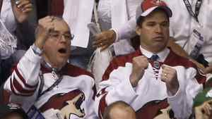 Chicago businessman and potential Phoenix Coyotes owner Matthew Hulsizer (R, in red Coyotes cap) and his father watch the the first period of Game 4 of an NHL Western Conference quarter-final hockey game between the Phoenix Coyotes and the Detroit Red Wings in Glendale, Arizona April 20, 2011.