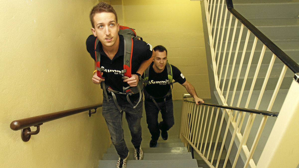 Adam Mc Clare (L) and his cousin Hart Togman practice climbing stairs at their apartment building on Pleasant Blvd., while preparing to climb Mount Cotopaxi in Ecuador