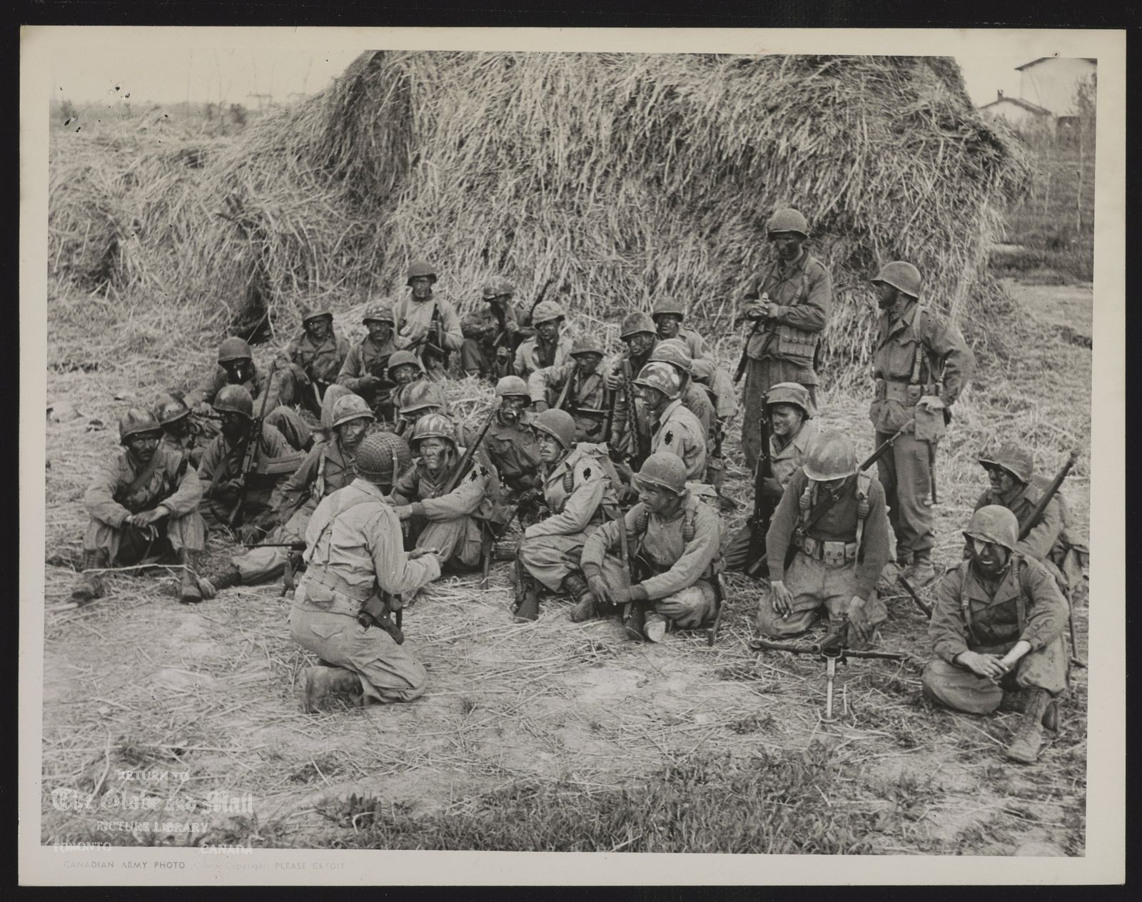THEY GOT WHAT IT TAKES A Canadian patrol being briefed before setting out on a dangerous mission in italy. The briefing officer is Lieut. H. Rayner of Toronto in foreground. (Canadian Army Overseas Photo)