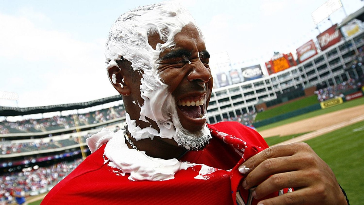 Right fielder Nelson Cruz #17 of the Texas Rangers reacts to a post-game cream pie in his face after the Rangers beat the Toronto Blue Jays 5-4 on Opening Day at Rangers Ballpark on April 5, 2010 in Arlington, Texas. (Photo by Tom Pennington/Getty Images)