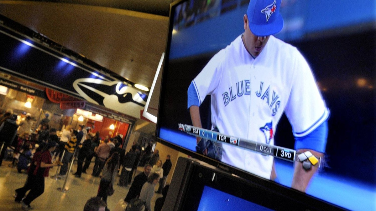 Fans can watch one of the hundreds of new tvs in the concourse level of the Rogers Centre, during a Blue Jays game in Toronto, April 27 , 2012.