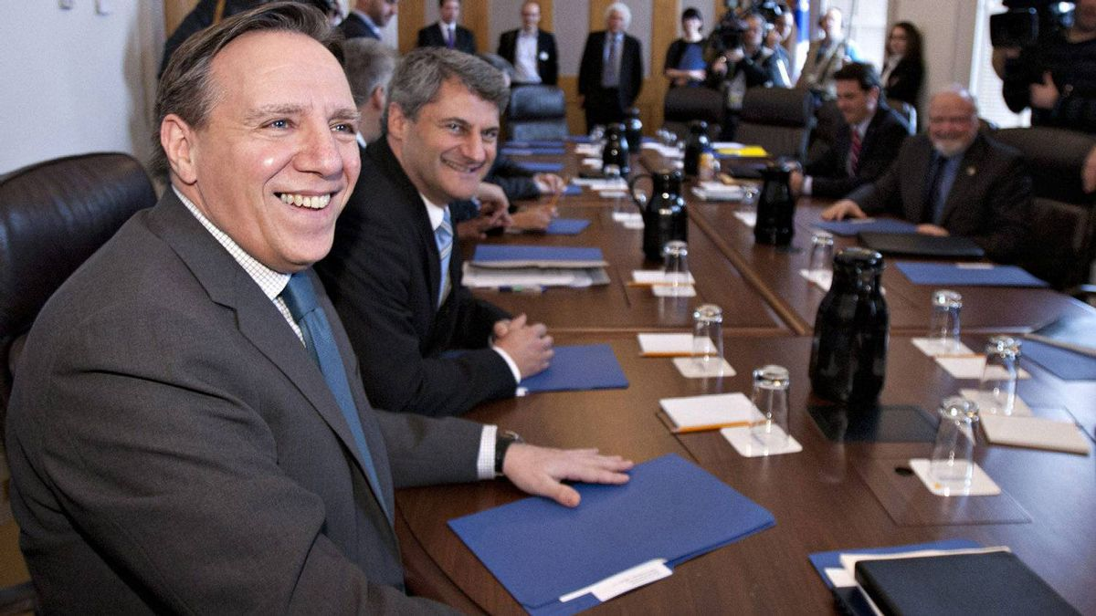 Francois Legault, left, leader of the Coalition Avenir Quebec and legislature party leader Gerard Deltell smile at their first party caucus Wednesday, January 25, 2012 at the legislature in Quebec City.