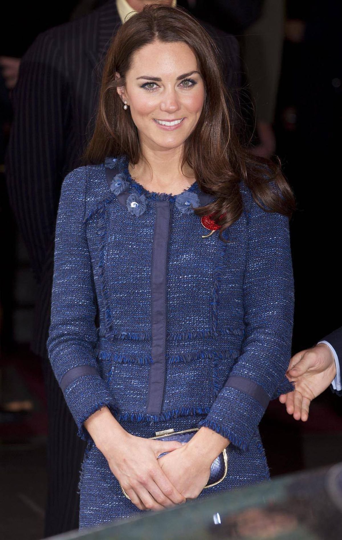 Kate wears a prim and proper blue tweed skirt and jacket by Rebecca Taylor to London's Goldsmiths's Hall on April 26.
