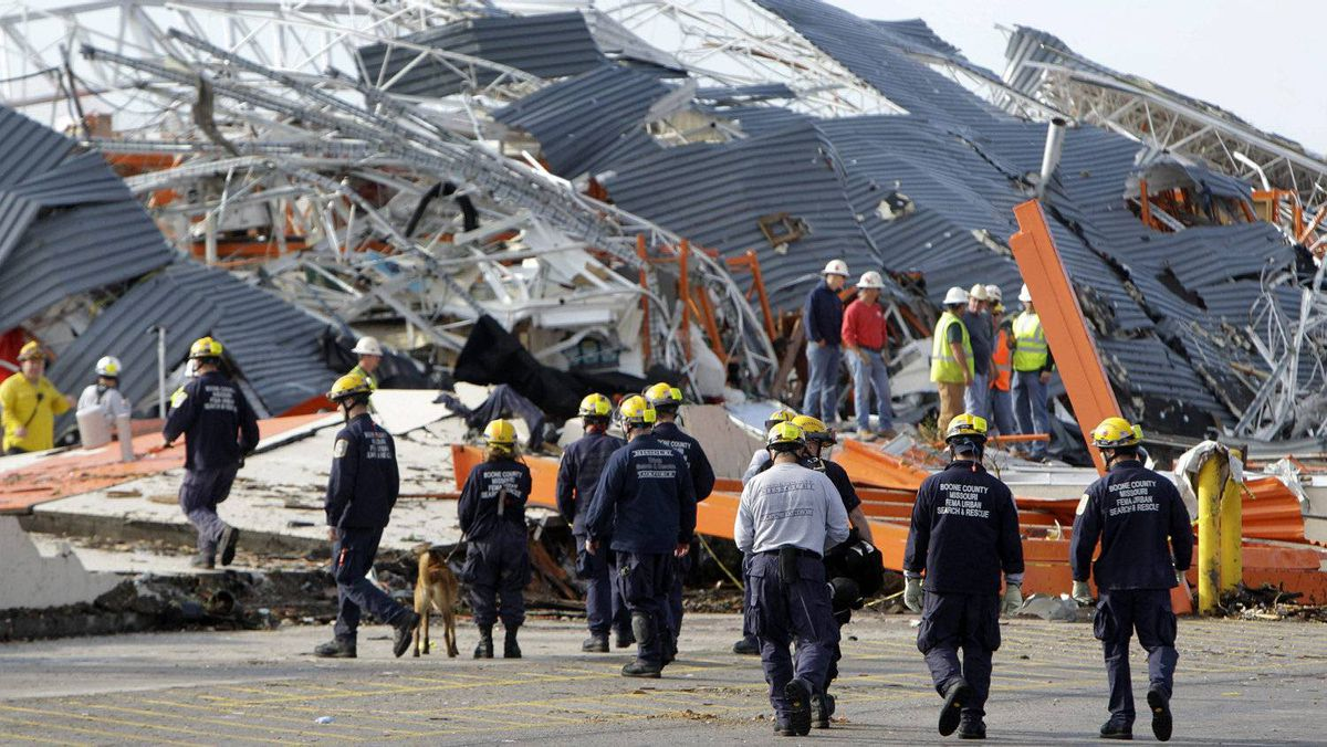 Members of Missouri Task Force One search-and-rescue team work at a tornado-damaged Home Depot store Tuesday, May 24, 2011, in Joplin , Mo. A large tornado moved through much of the city Sunday, damaging a hospital and hundreds of homes and businesses.