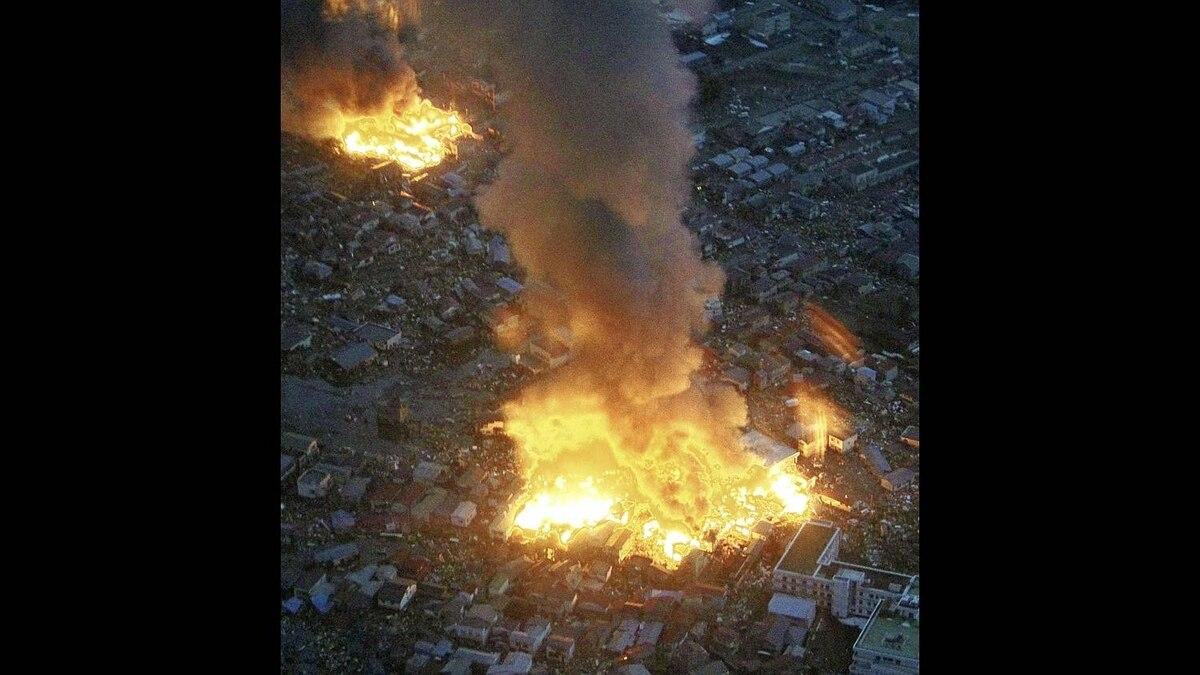 Buildings burn following an earthquake in Yamada town, Japan
