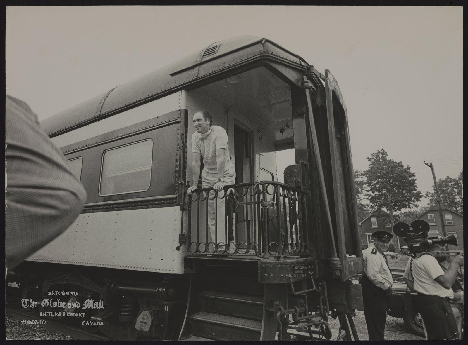 Pierre Elliott TRUDEAU Qubec. Politician. Prime Minister Trudeau stands on rear platform of his train at railway siding ain Stratford.