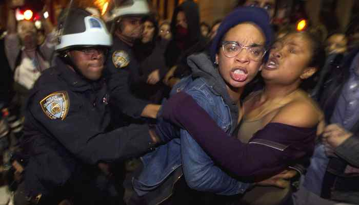 Members of the Occupy Wall St. movement clash with New York Police Department officers after being removed from Zuccotti Park in New York November 15, 2011. Police wearing helmets and carrying shields early on Tuesday began to clear the park in New York City's financial district, where protesters from the movement have been camping since September.