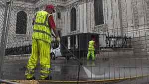 Workers use high pressure hoses to clean the plaza in front of St. Paul's Cathedral in London on Tuesday.