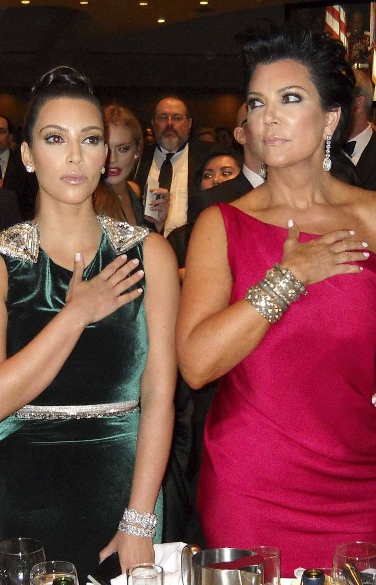 Kim Kardashian and her mother Kris Jenner, moved by the singing of the national anthem during the White House Correspondents' dinner in Washington, D.C., on Saturday, each put a hand to their massive hearts as they think of the tremendous opportunities and freedoms their great nation has given all Americans.