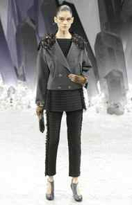 Crystals and embellished bits emerged from the shoulders of sporty jackets. Even the models' eyebrows appeared to be frosted in jewelled icicles.
