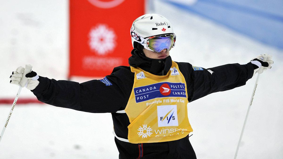 Mikael Kingsbury of Canada reacts after crossing the finish line in first place during the World Cup Freestyle moguls finals competition in Calgary January 28, 2012.