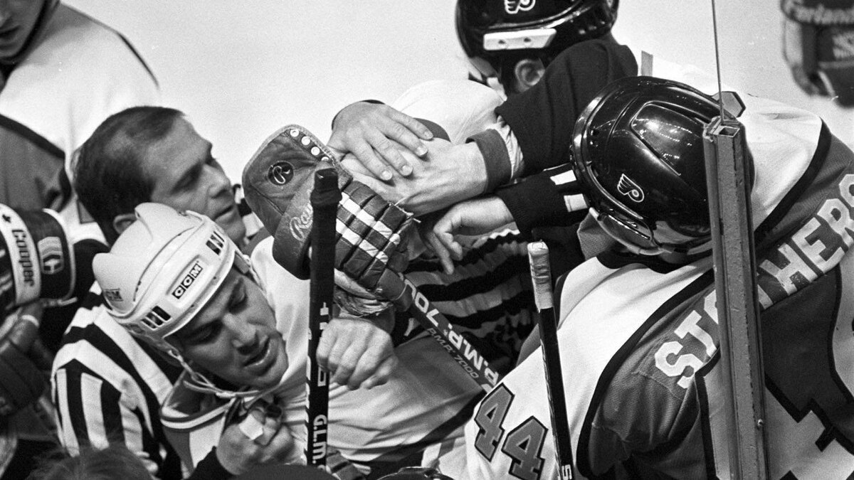 Montreal Canadiens Chris Chelios is roughed up by Philadelpihia Flyers Mike Stothers during a playoff brawl on May 14, 1987.