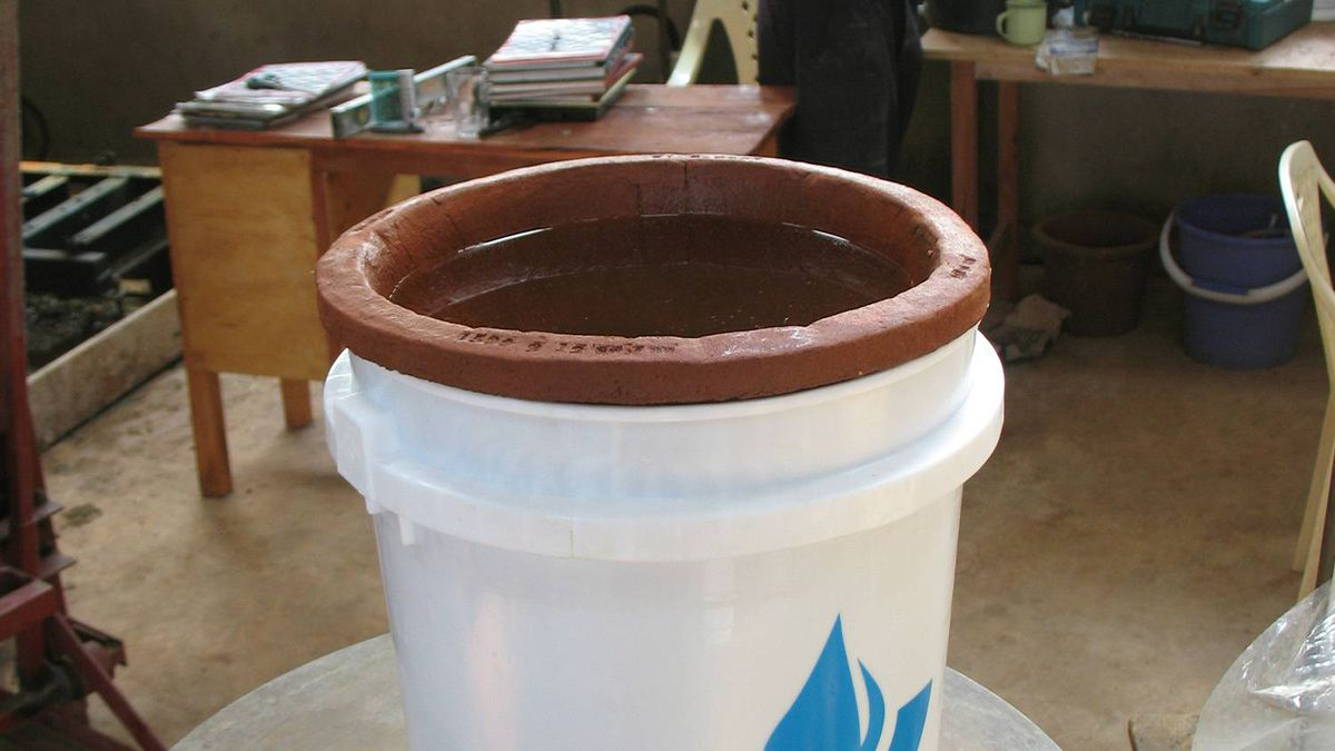 Each filter, shown here placed here in a plastic sleeve, costs about $10 and will serve a household of five people for two to three years. That $10 is less than the cost of one round of typhoid medication for just one person.