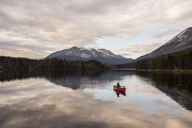 Canoeist on Turner Lake, Tweedsmuir South Provincial Park, B.C.