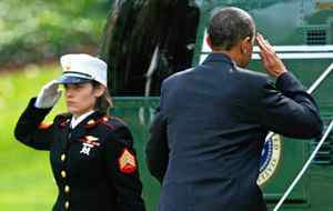 U.S. President Barack Obama salutes a Marine Corps honor guard as he boards the Marine One at the White House on Tuesday, November 4, 2009.