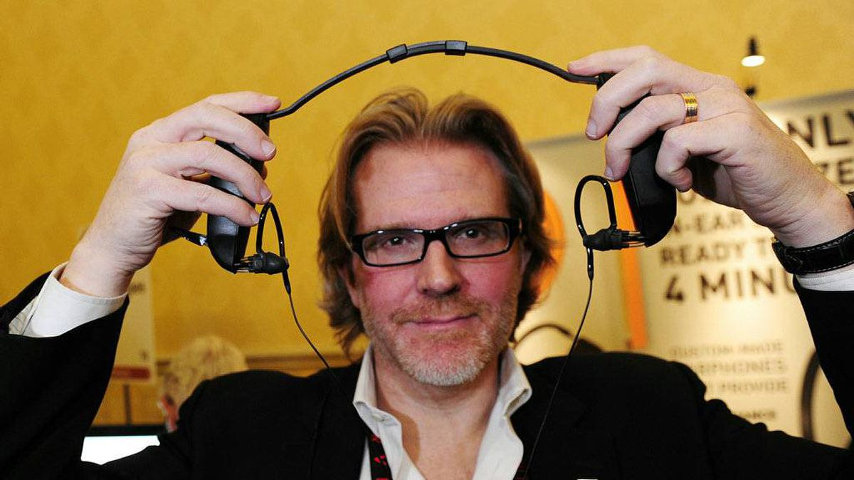 CEO Nick LaPerle of Montreal-based Sonomax Technologies displays his company's device for creating custom-molded earphones in only four-minutes by injected silicon into the deflated earbuds while they are seated inside the users' ears, on media preview day at the Consumer Electronics Show (CES) in Las Vegas, Nevada January 4, 2010.