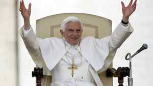 Pope Benedict XVI waves to the faithful as he leads the weekly audience in St. Peter's Square at the Vatican May 23, 2012.
