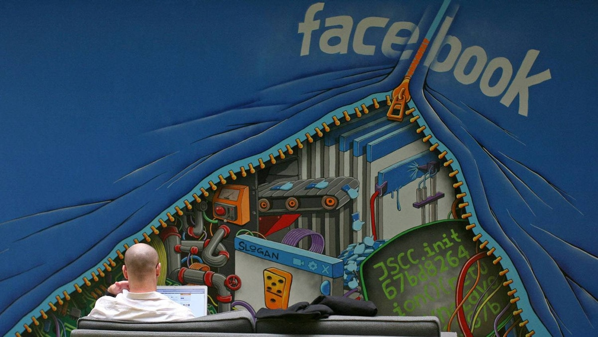An employee works on a computer at the new headquarters of Facebook in Menlo Park, California in this January 11, 2012 file photo. The attacks against Facebook signal that social media has become a new front in the Silicon Valley patent wars. Before 2010, online game developer Zynga, Web discount deals operator Groupon and professional social network operator LinkedIn had not faced a single patent lawsuit. Last year, the year those three companies went public, the lawsuits mounted.