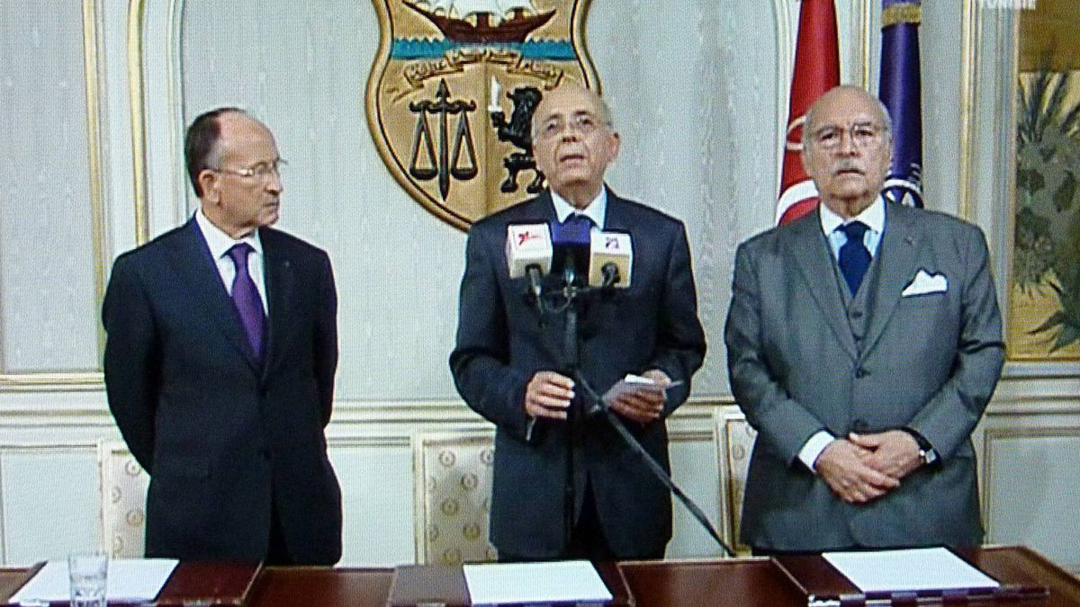 A photo taken from Channel 7 shows Tunisian Prime Minister Mohammed Ghannouchi, centre, addressing the nation on state television on Jan. 14, 2011, that he had taken over as interim president after Zine El Abidine Ben Ali had left the country.