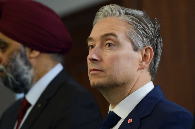 Champagne opens door to possible compensation for Kovrig, Spavor as they remain detained in China