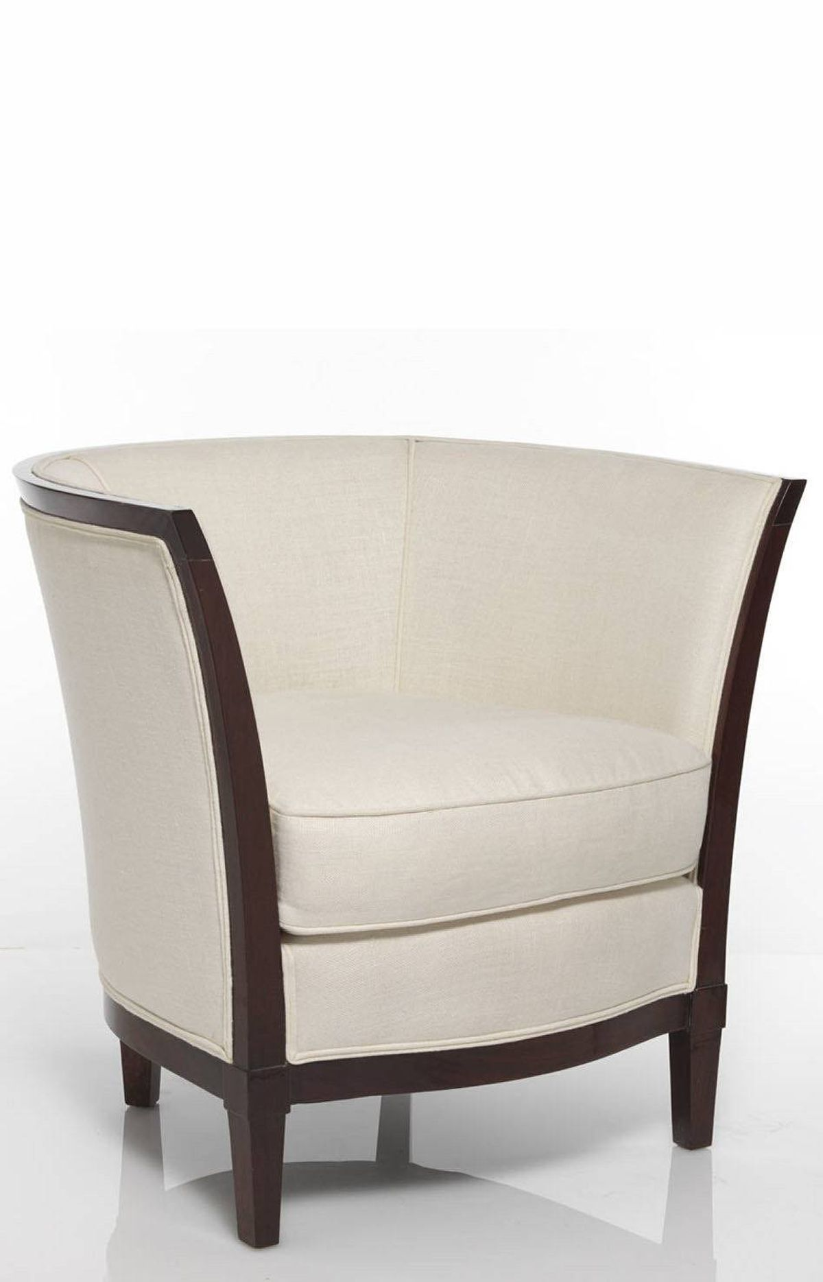 TREND: JAZZ-AGE Art-deco armchair upholstered in white linen with mahogany veneer frame, $3,900 at Trianon (www.trianon-online.com).
