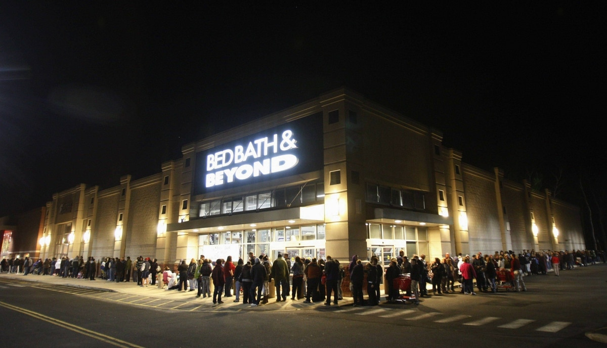 "Shoppers waiting in line for a Target store to open wrap around the side of a shopping complex on the shopping day dubbed ""Black Friday"" in Torrington, Connecticut November 24, 2011."