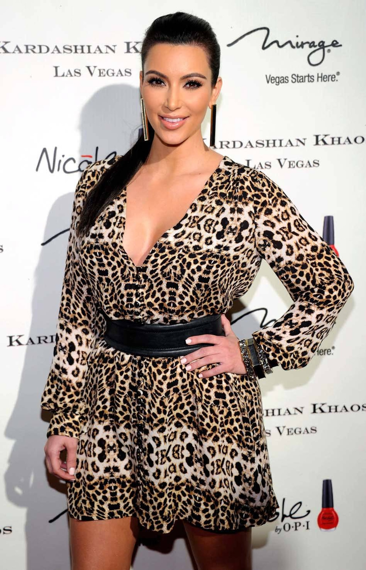 IF A COUPLE GETS MARRIED AND ONLY 9-MILLION PEOPLE WATCH, DOES IT STILL COUNT? Kim Kardashian attends the opening of the Kardashian Khaos store in Las Vegas on Dec. 15, capping a year -- okay, a summer -- during which she got engaged, married and separated. Oddly, the time period matched the shooting schedule of a reality show. Prediction: The bar for fake marriage has now been set so low that Jack Nicholson will give it a try.