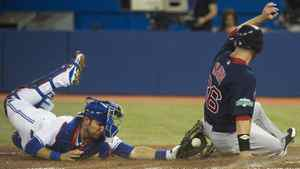 Toronto Blue Jays catcher J.P. Arencibia, left, is late with the tag as Boston Red Sox leftfielder Daniel Nava, right, slides safe at home plate to score a run during third inning AL baseball action in Toronto on Friday, June 1, 2012.