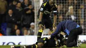 Bolton Wanderers' Nigel Reo-Coker helps a member of the club's medical staff attend to Fabrice Muamba after he collapsed on the pitch during their FA Cup quarter-final soccer match against Tottenham Hotspur at White Hart Lane in London March 17, 2012.