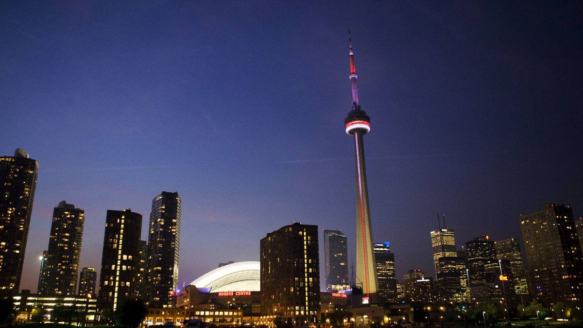 The CN Tower and Rogers Centre illuminate the Toronto skyline on August 19, 2011.