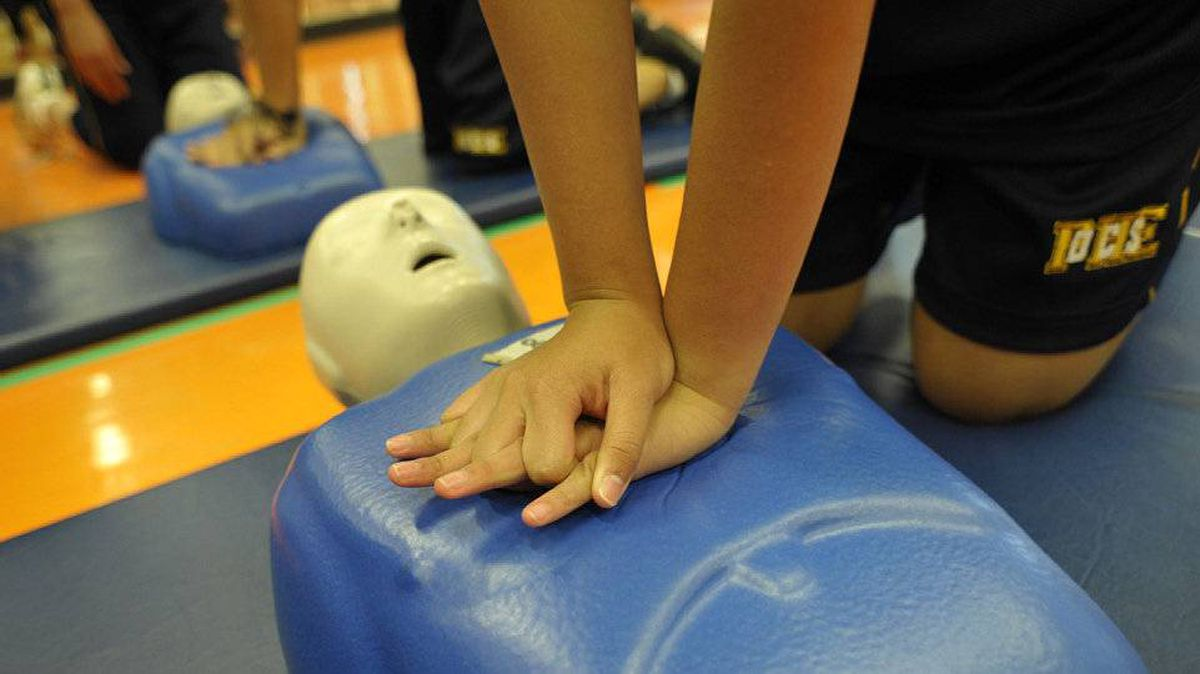 Students at Senator O'Connor College School practise CPR in Toronto, October 15 , 2010.