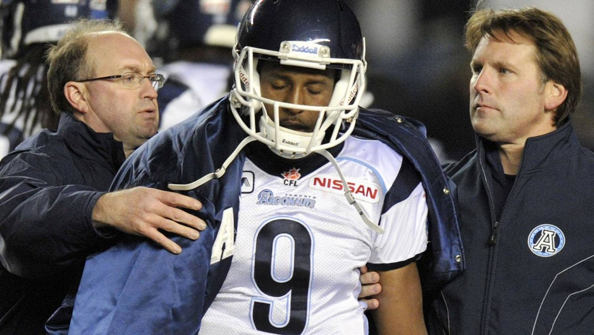 Toronto Argonauts quarterback Steven Jyles leaves the game with an injury after being hit by the Winnipeg Blue Bombers during the second half of their CFL game in Winnipeg, October 28, 2011. REUTERS/Fred Greenslade