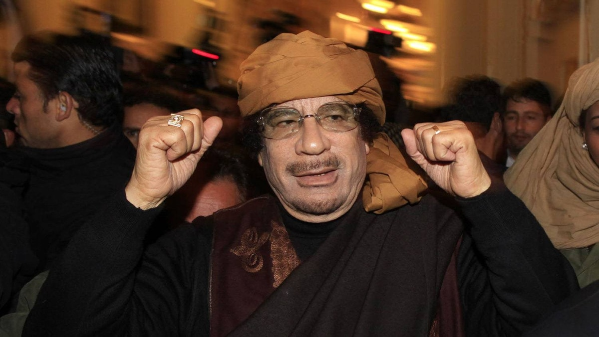 Libya's leader Muammar Gaddafi arrives to give television interviews at a hotel in Tripoli March 8, 2011.