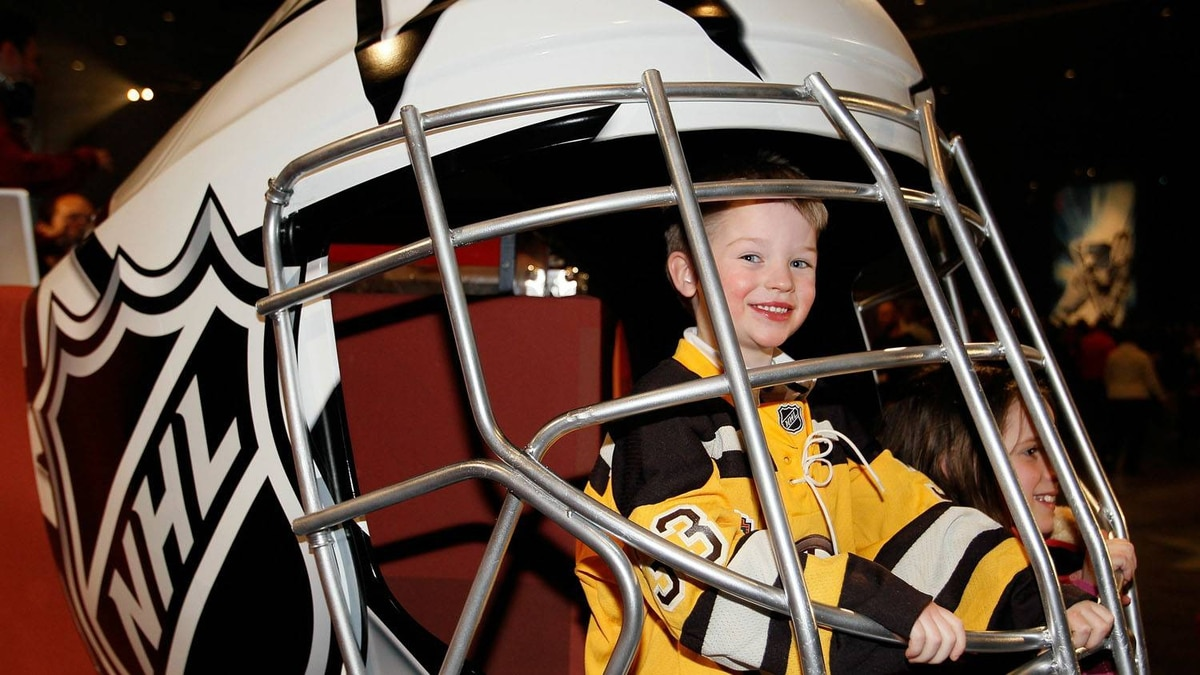 Sam Pollock, the son of NHL referee Kevin Pollock, pose inside a giant helmet inside the NHL Fan Fair part of 2011 NHL All-Star Weekend at the Raleigh Convention Center on January 28, 2011 in Raleigh, North Carolina. (Photo by Kevin C. Cox/Getty Images)
