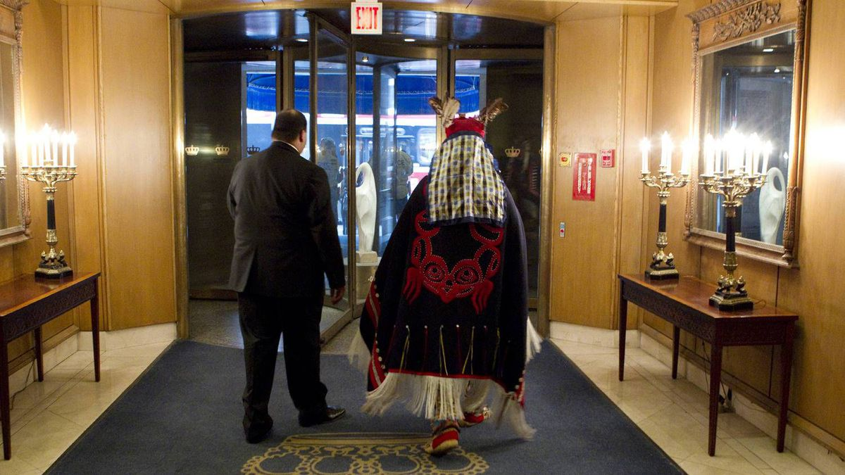 "Chief Martin Louie is escorted from the King Edward hotel after the Enbridge annual meeting. During the meeting, he told the board, ""we are not going to go away."""