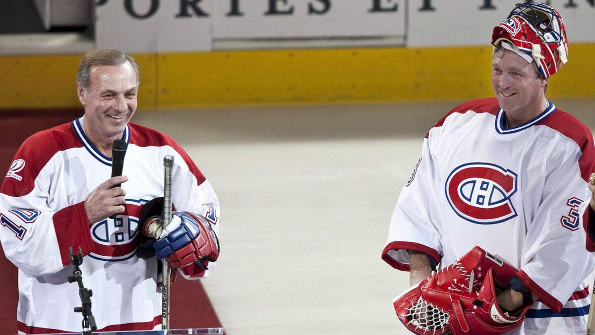 Former Montreal Canadiens goaltender Patrick Roy laughs as former Canadiens great Guy Lafleur addresses the crowd in Montreal in 2009.
