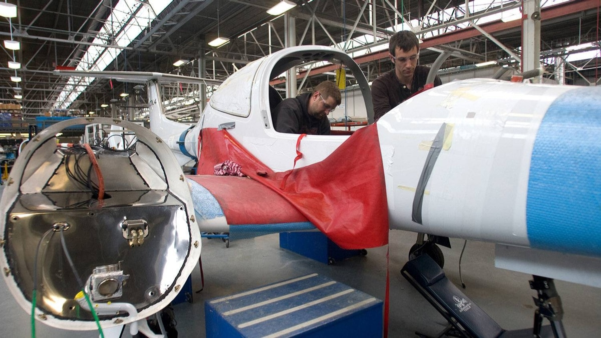 Avionics technicians Derek Dunn, left, and Shaun Courtepatte install a relay into a twin engine plane at Diamond Aircraft, in London, Ont. The company employs just under 200 workers in a factory that used to build de Havilland Mosquito fighters during the Second World War.