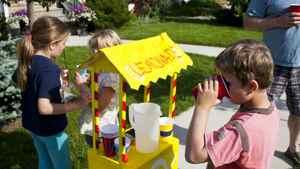 Neighbourhood kids run a lemonade stand on the front street of their Calgary neighbourhood of Garrison Woods.