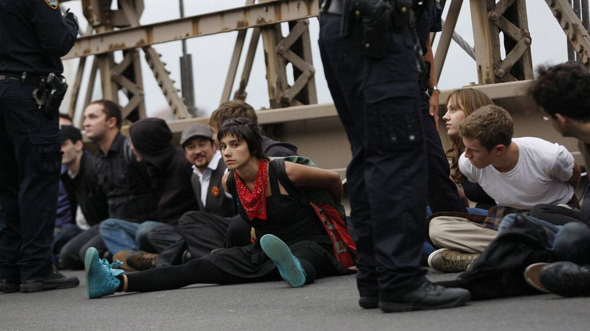 When arrested, protesters were restrained with plastic handcuffs.