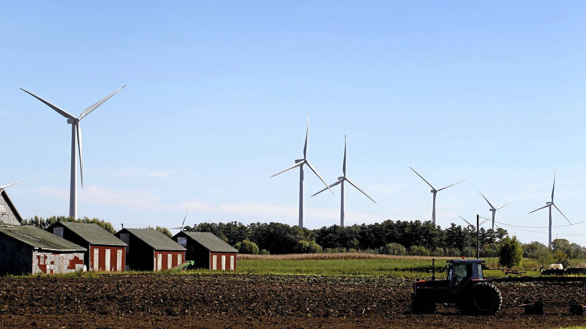 Large wind turbines dot the landscape and cut into the skyline in Norfolk County in Southwestern Ontario.
