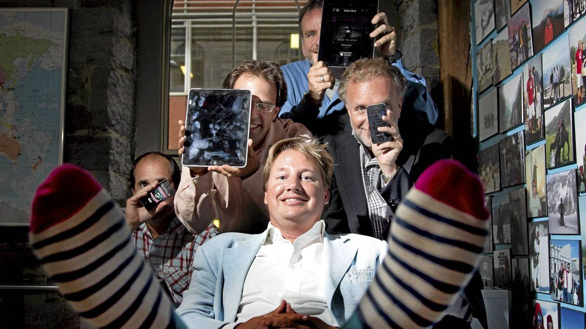 Eric Boyko (C), president of Stingray Digital with his management team in Montreal , Aug. 15, 2011. Christinne Muschi for The Globe and Mail
