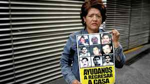 Marina Armenta, whose husband Eduardo Toyota Espinoza disappeared in Jun 2009 in the town of Nuevo Laredo in the north of Mexico, photographed while holding a picture of her him in Mexico City, May 13, 2012.
